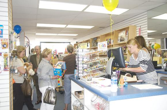 "Shoppers line up to buy items at Toy Boat Toy Boat Toy Boat during a ""cash mob"" Tuesday."