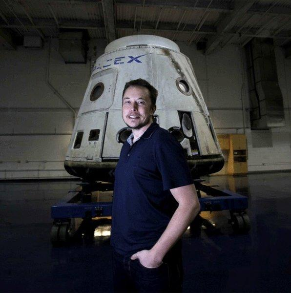 Elon Musk with the SpaceX Dragon capsule on display at the Hawthorne-based Space Exploration Technologies Corp.
