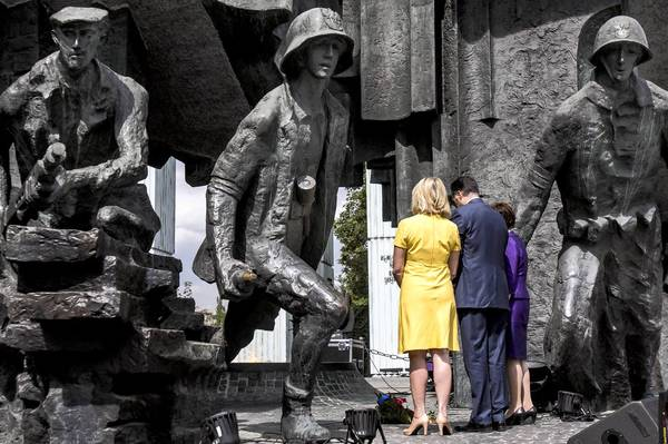 Republican presidential candidate Mitt Romney and his wife Ann visit the Memorial of the Warsaw Uprising Tuesday in Warsaw, Poland.
