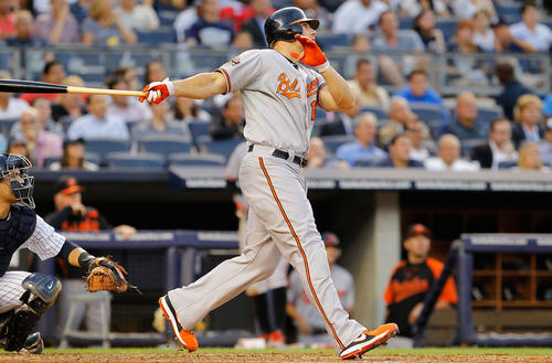 Chris Davis follows through on his second inning grand slam against theYankees on Tuesday night.