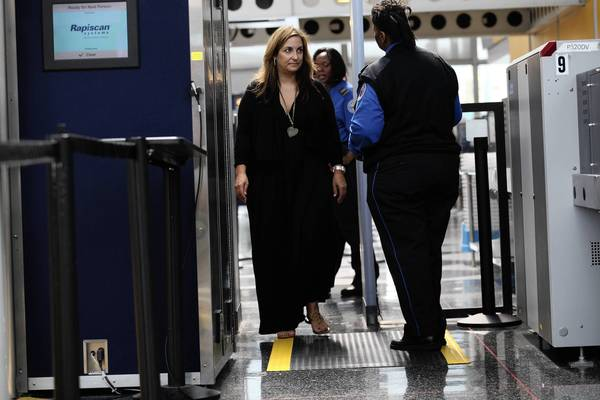Kimberly George of Wilmette goes through the Transportation Security Administration's PreCheck security process at O'Hare International Airport.