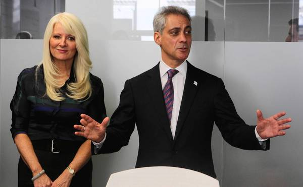 Mayor Rahm Emanuel speaks at the Accretive offices on LaSalle Street in downtown Chicago alongside Mary Tolan, company founder and CEO, in March.