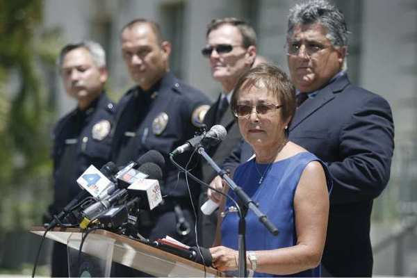 Sen. Carol Liu listens to a question from the media after discussing the Senate Bill 1089 which aims to prevent abuse in private boot camps at a press meeting in front of Pasadena City Hall.