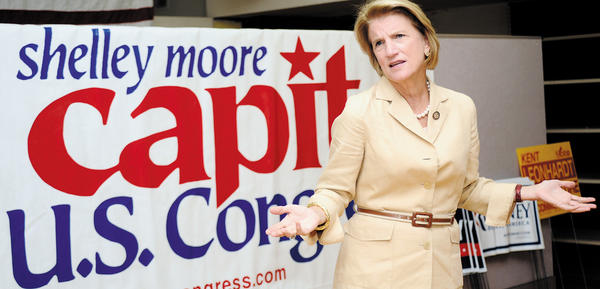 "U.S. Rep. Shelley Moore Capito, R-W.Va., shares motivational words Tuesday afternoon with GOP candidates who attended the opening of the West Virginia GOP ""victory office"" in downtown Martinsburg, W.Va."