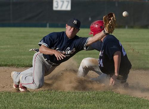 Limeport Bulls shortstop Randy Sandercock (right) slides safely into second base, as Northern Yankees shortstop Nick Rabasco (left)  fields a ball hit by Limeport's Justin Fizer in the top of the third inning during Tri-County League baseball playoff game at Scherersville on Tuesday