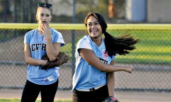 Crescenta Valley-Foothill pitcher and third baseman Adela Alatraca, right, takes part in a team practice before the team takes to the Western Regional Tournament.