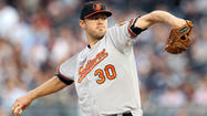 Chris Tillman battles through illness and early struggles to get a win