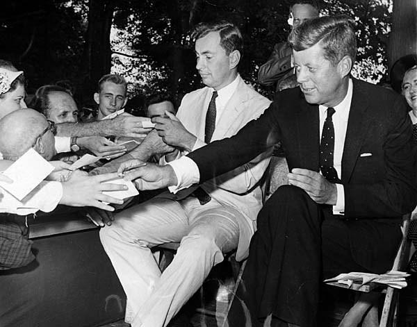 Democrats Gore Vidal and Sen. John F. Kennedy give autographs to voters during a 1960 campaign stop in New York state. Vidal lost his bid for New York's 29th Congressional District.