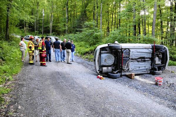 A car sits on its side on Back Road, Ryan Township, after it crashed Tuesday evening, killing the driver, 18-year-old Jonathan Palubinsky. His four teen passengers suffered minor or no injuries in the Schuylkill County accident.