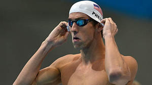 After emotional, record-setting night, it's back to the pool for Phelps