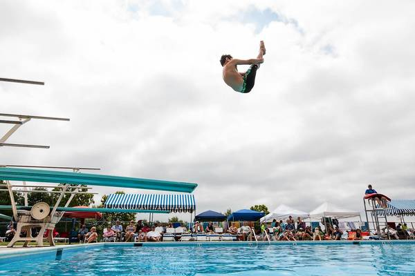 Forest Hill swimmer Mark Bruner flips through the air while competing in the Boys 11/12 division.