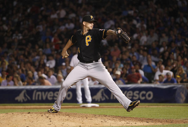 Pirate A.J. Burnett pitches against the Cubs Tuesday night.