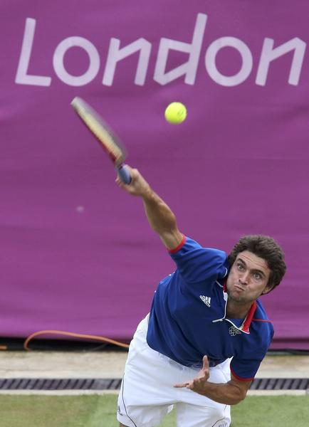 France's Gilles Simon serves to Argentina's Juan Martin del Potro in their men's singles tennis match at the All England Lawn Tennis Club during the London 2012 Olympic Games on August 1.