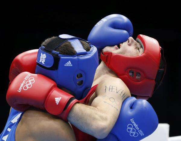 Ireland's John Joe Nevin (right) fights Kazakhstan's Knat Abutalipov in a Men's Bantam (56kg) boxing match.