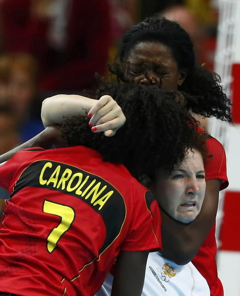 Montenegro's Milena Knezevic (center) struggles between Angola's Carolina Morais (left) and Magda Cazanga in their women's handball Preliminaries Group A match at the Copper Box venue during the London 2012 Olympic Games on August 1.
