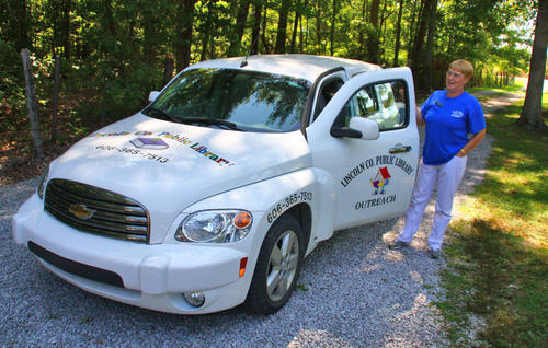Beverly Madden gets into her library vehicle after delivering books to a home July 26.