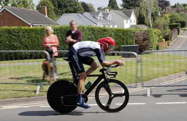Bradley Wiggins cycles his way to a gold medal, becoming the most decorated Olympian in British history.