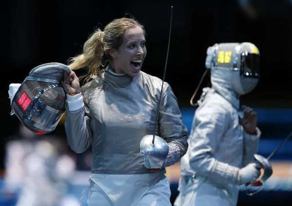 Mariel Zagunis celebrates her victory over China's Min Zhu on her way to the saber fencing semifinals Wednesday.