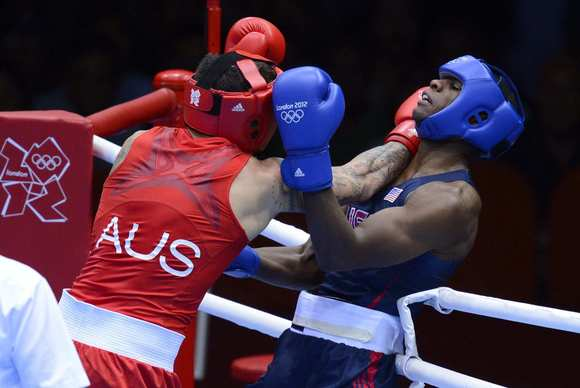 U.S.boxer Marcus Brown, right, loses his light heavyweight match to Australia's Damien Hooper.