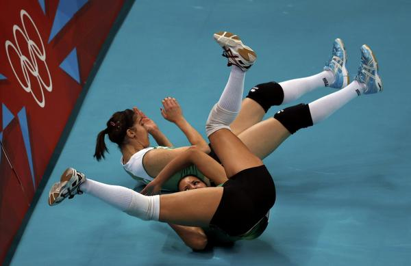 Algeria's Safia Boukhima and Sehryne Hennaoui collide after chasing a ball during their women's Group A volleyball match against Russia.