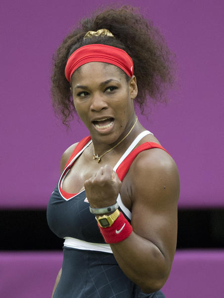 Serena Williams celebrates after a shot to Russia's Vera Zvonareva during their women's singles tennis match at the 2012 London Olympic Games at the All England Tennis Club in Wimbledon.