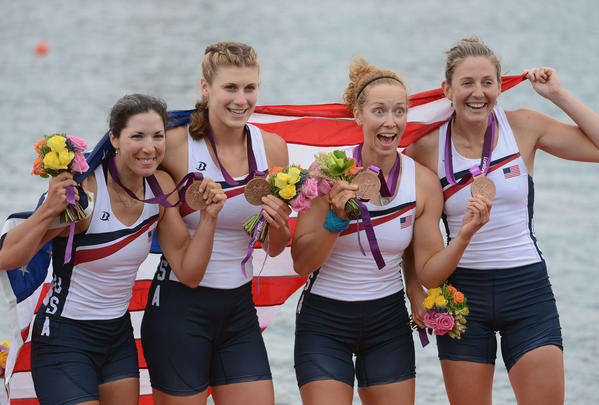 Adrienne Martelli, Megan Kalmoe, Kara Kohler and Natalie Dell of the United States celebrate on the podium after winning bronze in the Women's Quadruple Sculls on Day 5 of the London 2012 Olympic Games at Eton Dorney in Windsor, England.