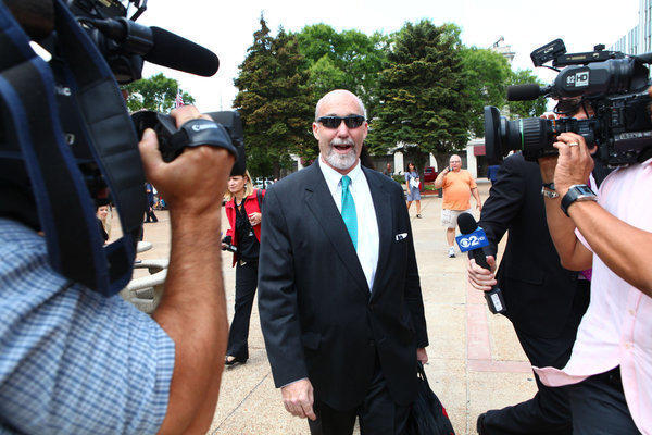 "Attorney Joel Brodsky tells reporters he has ""No comment at this time!"" as he leaves for lunch on the second day of the Drew Peterson trial at the Will County Courthouse in Joliet."