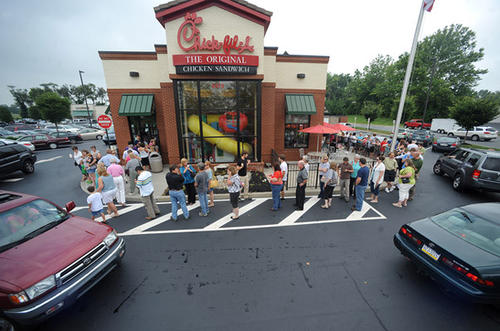 Supporters line-up around Chick-fil-A in Trexlertown Wednesday afternoon for lunch to show their support for the company's stance in favor of traditional marriage.