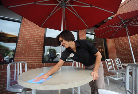 Eva Wilson 20, of Orefield a team leader for Chick-fil-A in Trexlertown cleans off table to keep up with the volume of supporters Wednesday afternoon during lunch time.