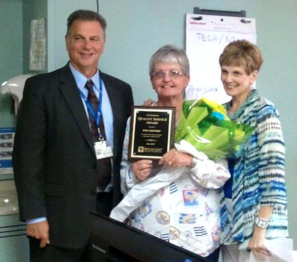 City Hospital's May Quality Service Award winner, Pam Gesford, center, is pictured with Anthony Zelenka, chief administrative officer at City Hospital, and Stephanie Harvey, education director.