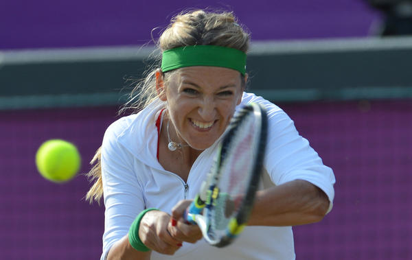 Victoria Azarenka of Belarus competes against Russia's Nadia Petrova during a third-round Women's Singles tennis match on Aug. 1.