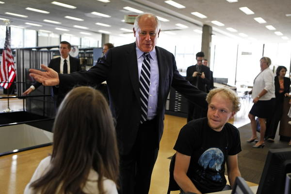 Gov. Pat Quinn tours IIT before signing into a law a bill barring companies from asking workers and applicants for social media passwords.