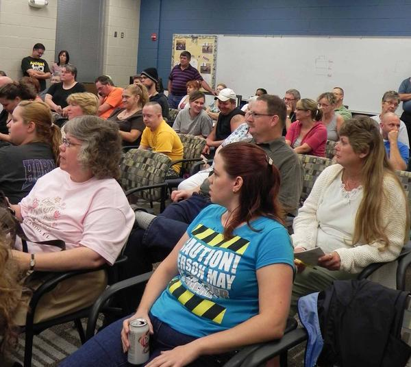 Some of the 200 people who rent duplexes and townhouses at the former Fort Ritchie U.S. Army base gathered Tuesday night to question the property's new owners about the site's future.