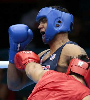 Russia's Magomed Omarov, foreground, fights Dominic Breazeale of the U.S. during their super heavyweight (over 91kg) boxing match.