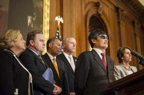 Chinese human rights activist Chen Guangcheng speaks to the media after a meeting with House Speaker John A. Boehner (R-Ohio) and House Minority Leader Nancy Pelosi (D-San Francisco) at the Capitol in Washington.