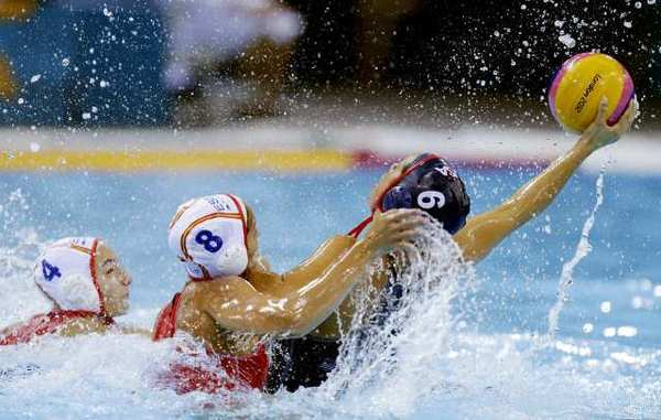 Maggie Steffens of the United States, right, is challenged by Pilar Pena Carrasco of Spain during their women's water polo preliminary-round match Wednesday.
