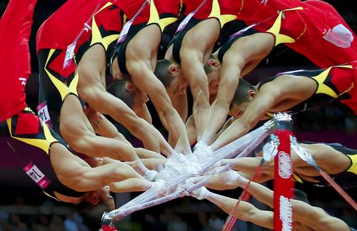 Marcel Nguyen of Germany competes on the horizontal bar during the Men's individual all-around gymnastics final.