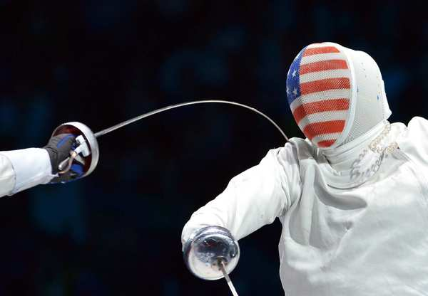 "U.S. fencer Weston ""Seth"" Kelsey takes a hit from Venezuela's Ruben Limardo Gascon during the men's epee semifinals. Kelsey would lose this match and then a bronze medal bout, continuing a long drought for the U.S. men without a medal in fencing. Limardo Gascon continued to win gold."