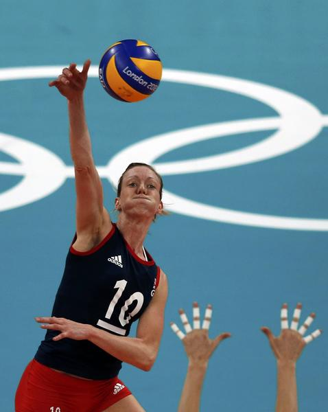 Britain's Lynne Beattie spikes the ball during a Women's Group A volleyball match against Italy.