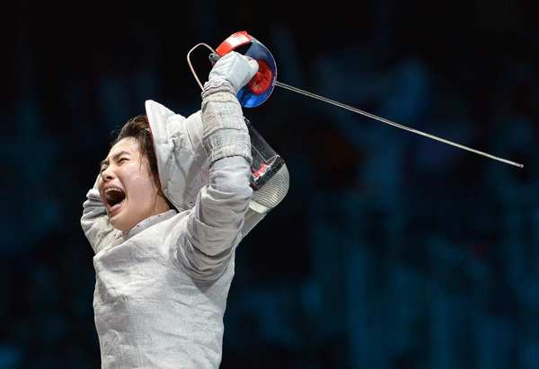 South Korea's Kim Jiyeon celebrates her upset victory over U.S. fencer Mariel Zagunis in the women's sabre semifinal bout. She went on to win the gold medal.