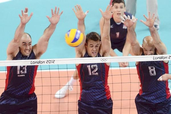 Fountain Valley High graduate Russell Holmes, No. 12, goes up for a block during Tuesday's match against Germany.