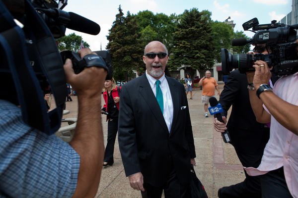 Attorney Joel Brodsky declines comment as he leaves he Will County Courthouse. The court was adjourned early after the defense made a motion for a mistrial in the murder trial of Drew Peterson for the death of Kathleen Savio.