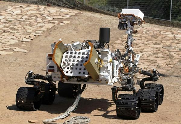 An engineering model of NASA's Curiosity Mars rover is seen from the rear in a sandy, Mars-like environment named the Mars Yard at NASA's Jet Propulsion Laboratory in Pasadena, Calif.