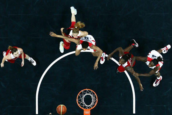 Players wait for a rebound in the women's basketball game between the United States and Turkey.