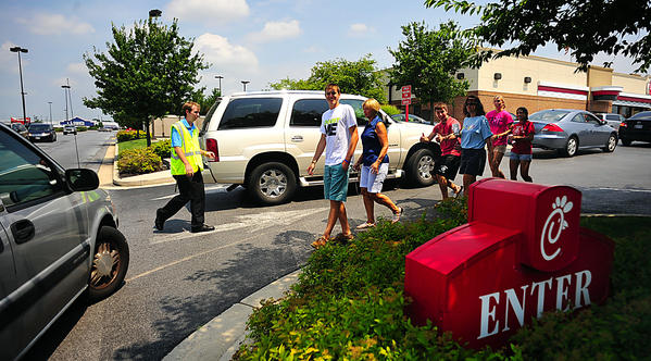Satisfied Chick-fil-A customers depart the restaurant Wednesday afternoon at the Wesel Boulevard location. There was an increase of business at the fast-food reataurant as people showed support of recent political comments made by the corporation's chief executive officer.