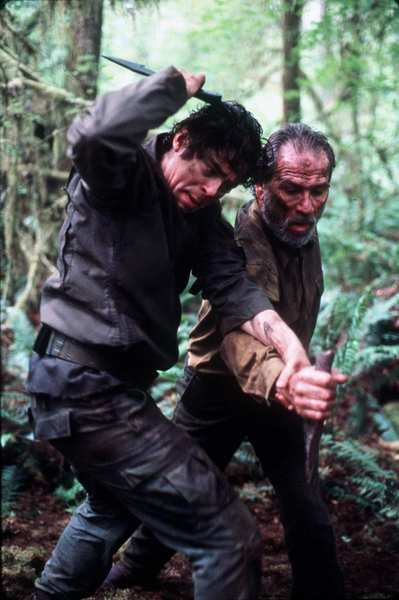 "Benicio Del Toro, left, and Tommy Lee Jones in 2002's ""The Hunted."""