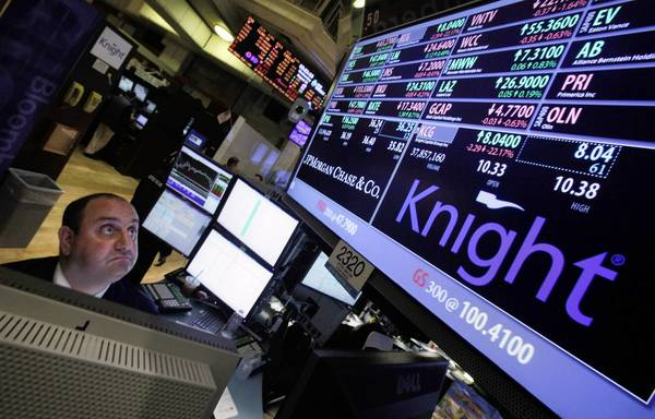 Specialist Peter Giacchi looks at prices on the floor of the New York Stock Exchange. Traders saw unusually sharp moves in a number of stocks shortly after the opening bell, a problem later blamed on technical issues at brokerage Knight Capital Group.