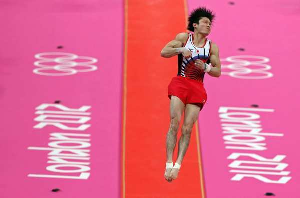Kohei Uchimura of Japan competes on the vault in the the artistic gymnastics men's individual all-around. He took home his first gold medal in the event.