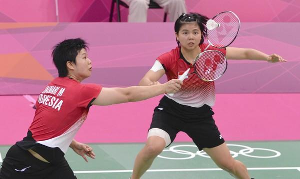 The ouster of eight Olympic badminton players, including Indonesia's Meiliana Jauhari, left, and Greysia Polii, raises a question for sports players. Have you ever sandbagged?