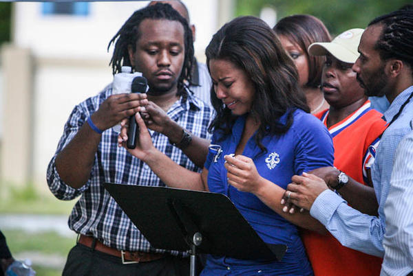 "Baje Fletcher, center, the sister of Danielle Sampson, is overcome with emotion during a prayer vigil at The Well of Hope church in <a class=""taxInlineTagLink"" id=""PLGEO100100410160000"" title=""Pine Hills"" href=""/topic/us/florida/orange-county-%28florida%29/pine-hills-PLGEO100100410160000.topic"">Pine Hills</a>  on Wednesday, August 1, 2012."